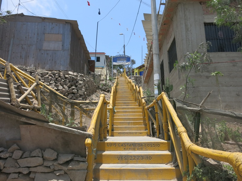 villa-el-salvador-hillside-shantytown-slums-yellow-staircases-steps